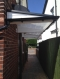 Palace Cantilever Canopy to cover a walk way at the side of your property.